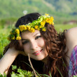 Young beautiful girl laying on the  flowers dandelions, outdoor portrait, summer fun concept — Stock Photo