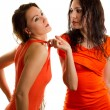 Two sexy Russian girlfriend try on clothes on a white background isolated - Stock Photo