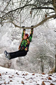 Woman in ski suit on tree in snowy winter outdoors in Kazakhstan — Stock Photo