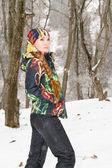 Woman in ski suit on tree in snowy winter outdoors in Kazakhstan — Stock Photo