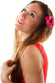 Russian woman laughing with a flower in long hair on a white background — Stock Photo