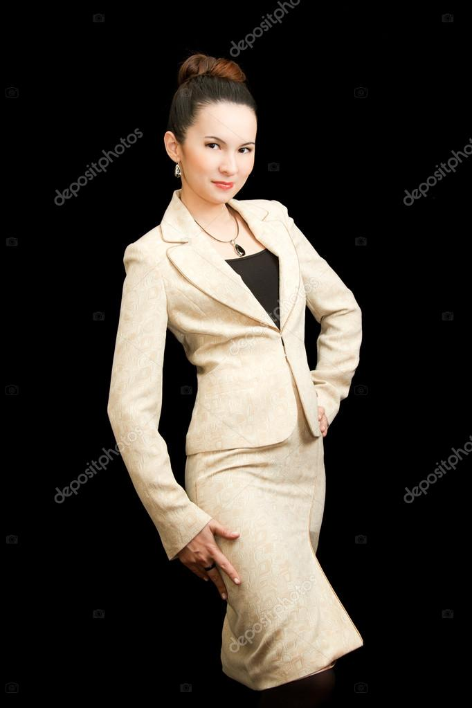 Asian businesswoman in a strict light-colored suit on a black background isolated — Stock Photo #14921493