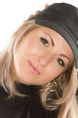 Portrait of blond lady with a beautiful blonde hair in cap isolated on white — Stock Photo