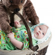 Baby girl in a basket with toy bear isolated on white background .The concept of childhood and holiday — Stock Photo #16645735
