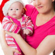 Mom and santa baby daughter celebrate Christmas on isolated white background. The concept of childhood and holiday — Stock Photo #16645737