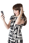 Portrait of beautiful woman talking on a mobile phone on isolated white background — Stock Photo