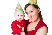 Happy mom and baby celebrating happy birthday on isolated white background. Use it for a child, parenting and holiday — Stock Photo