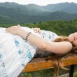 Beautiful pregnant woman with long hair meditating and relax on nature of Almaty — Stock Photo #21510725