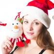 Portrait of woman in santa cap with snowman on white background. The concept of holiday and christmas — Stock Photo