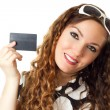 Portrait of young shopping woman holding credit card isolated on white background - Stock Photo