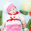 Baby girl wearing a chef hat with vegetables. Use it for a child, healthy food concept — Stock Photo #21510833