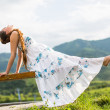 Beautiful pregnant woman meditating on nature of Almaty Young woman doing yoga — Stock Photo