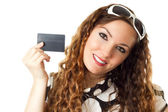 Portrait of young shopping woman holding credit card isolated on white background — Stock Photo
