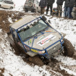 "Almaty, Kazakhstan - February 21, 2013. Off-road racing on jeeps, Car competition,  ATV. Traditional race ""Kaskelen gullies"" Cup  the Republic of Kazakhstan trophy-raid - Stock Photo"