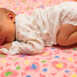 Newborn baby sleeps on bed. Use it for a child, parenting or love concept — Stock Photo