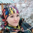 Beautiful woman in ski suit in snowy winter outdoors,  Almaty, Kazakhstan, Asia - Стоковая фотография