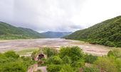 Mountain panorama with green mountains and blue sky,Kura River — Stock Photo