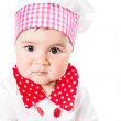 Baby girl wearing a chef hat with tomato . Use it for a child, healthy food concept — Stock Photo #25788353