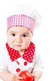 Baby girl wearing a chef hat with tomato . Use it for a child, healthy food concept — Stock Photo