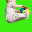 Baby boy playing with a soccer ball on green background. Babies And Children — Stock Photo