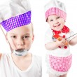 Children cook boy and girl wearing a chef hat with pan isolated on white background.The concept of healthy food and childhood — Stock Photo