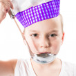 Child boy cook wearing a chef hat with pan isolated on white background.The concept of healthy food and childhood — Stock Photo #26227749