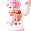 Baby girl cook wearing a chef hat with vegetables and pan isolated on white background.The concept of healthy food and childhood — Stock Photo #26227783