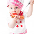 Baby girl cook wearing a chef hat with vegetables and pan isolated on white background.The concept of healthy food and childhood — Stock Photo