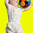 Baby boy playing with a soccer ball on color background Babies And Sport — Stock Photo