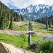 Stock Photo: Pipeline on road Big Almaty Lake, Tien ShMountains in Almaty, Kazakhstan,Asia