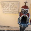 Stock Photo: Greek religious symbol,cross,plaque with name on wall of monastery in Crete, Greece