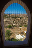 View through window on Messara Valley at Crete island in Greece. Messara - is the largest plain in Crete — Stock Photo