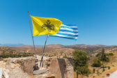 National flag on the roof of Monastery (friary) in Messara Valley at Crete island in Greece. — Stock Photo