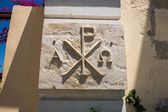 Coat of arms and Greek religious symbol,cross on wall of monastery in Crete, Greece — Stock Photo