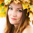 Beautiful fall woman. Portrait of girl with autumn wreath of maple leaves on head on isolated white background — Stock Photo