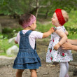 Stock Photo: Two year-old adorable child girls playing on nature summer