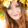 Beautiful fall woman. Portrait of girl with autumn wreath of maple leaves on head on isolated white background — Stock Photo #29714459