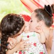 Happy mom and godmother kissing baby girl . The concept of childhood and family. — Stock Photo