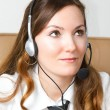 Portrait of happy smiling cheerful support phone operator in headset at office. CUSTOMER SERVICE AGENT — Foto de Stock