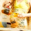 Pregnant woman with a cap of tea on kitchen. The concept of drinking and a healthy lifestyle — Stock Photo #30496173