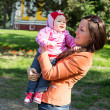 Happy mom and child girl hugging. The concept of childhood and family. Beautiful Mother and her baby outdoors — Stock Photo