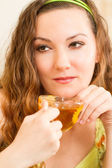 Portrait of young beautiful woman with tea. The concept of eating and drinking — Stock Photo