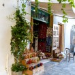 Stock Photo: Street shop with ornaments, gift, souvenir in Small cretvillage in Crete island, Greece. Building Exterior of home.