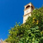 The clock tower in Small cretan village in Crete island, Greece. Building Exterior of home. — Stock Photo