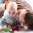 Beautiful mother kissing sweet baby boy — Stock Photo