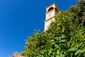The clock tower in Small cretan village in Crete island, Greece. Building Exterior of home. — Stock Photo