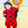 baby girl, dressed in ladybug costume  — Foto de Stock