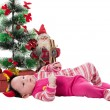 Santa baby girl near Christmas tree  — Stock Photo