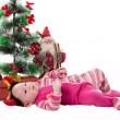 Santa baby girl near Christmas tree — Stock Photo