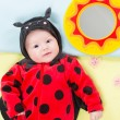 Baby girl, dressed in ladybug costume — Stock Photo